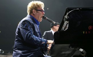 Elton John performing at the piano